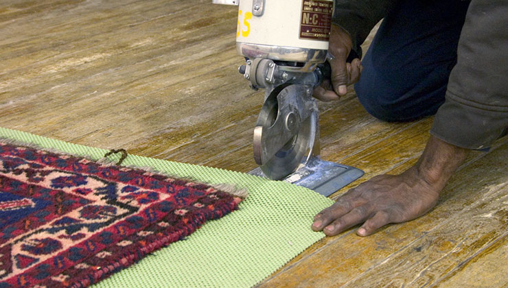 Photo of padding being cut for an area rug.
